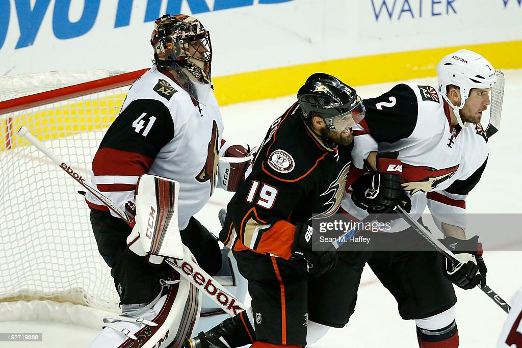 Mike Smith #41 of the Arizona Coyotes,Nicklas Grossmann #2 of the Arizona Coyotes, push against Patrick Maroon #19 of the Anaheim Ducks during the third period of a game at Honda Center on October 14, 2015 in Anaheim, California.