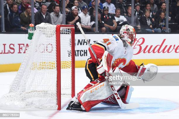 Mike Smith of the Calgary Flames defends the net during a game against the Los Angeles Kings at STAPLES Center on October 11 2017 in Los Angeles...