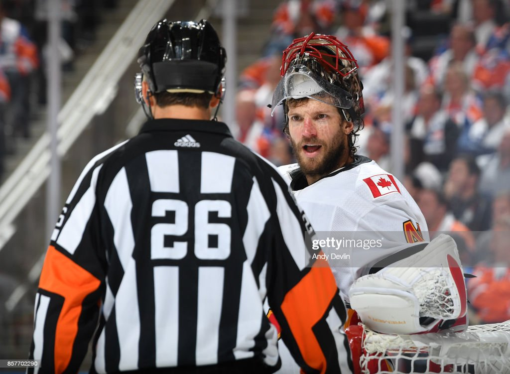 Mike Smith #41 of the Calgary Flames discusses the play with an official during the game against the Edmonton Oilers on October 4, 2017 at Rogers Place in Edmonton, Alberta, Canada.