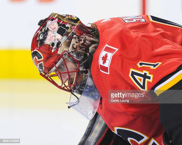 Mike Smith of the Calgary Flames in action against the Winnipeg Jets during an NHL game at Scotiabank Saddledome on October 7 2017 in Calgary Alberta...