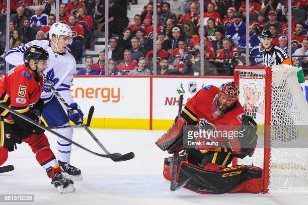 Mike Smith of the Calgary Flames makes a glove save on the shot of William Nylander of the Toronto Maple Leafs during an NHL game at Scotiabank...