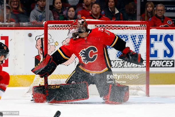 Mike Smith of the Calgary Flames makes a save against the Arizona Coyotes during an NHL game on November 30 2017 at the Scotiabank Saddledome in...