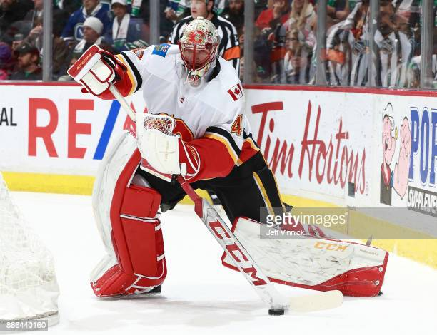 Mike Smith of the Calgary Flames plays the puck during their NHL game against the Vancouver Canucks at Rogers Arena October 14 2017 in Vancouver...
