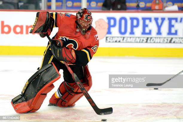 Mike Smith of the Calgary Flames skates in the warmup before an NHL game against the Dallas Stars on October 27 2017 at the Scotiabank Saddledome in...