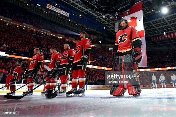 Mike Smith of the Calgary Flames stands for the national anthem ceremony against the Winnipeg Jets during an NHL game on October 7 2017 at the...