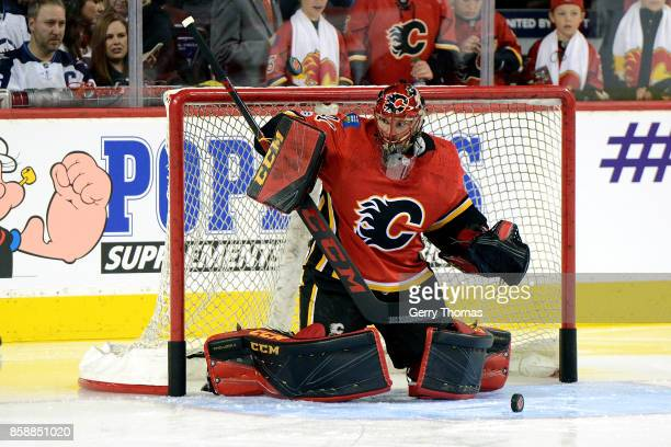 Mike Smith of the Calgary Flames takes some practice shots during an NHL game against the Winnipeg Jets on October 7 2017 at the Scotiabank...