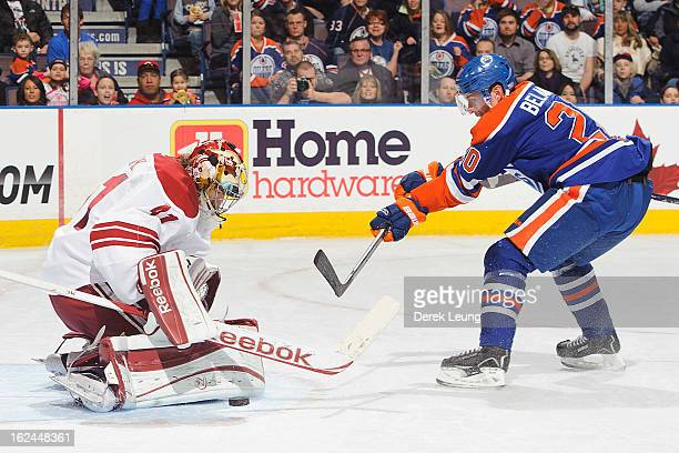 Mike Smith of the Minnesota Wild stops the shot of Eric Belanger of the Edmonton Oilers during an NHL game at Rexall Place on February 23 2013 in...