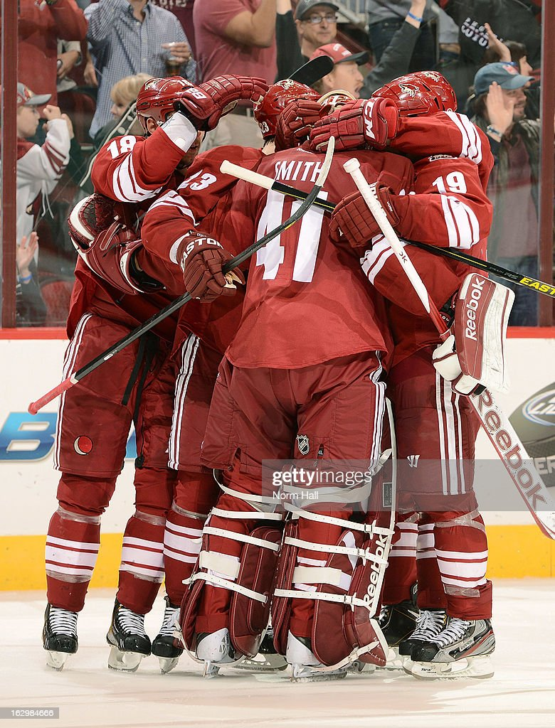 Mike Smith #41 of the Phoenix Coyotes and teammates celebrate a shootout win against the Anaheim Ducks at Jobing.com Arena on March 2, 2013 in Glendale, Arizona.