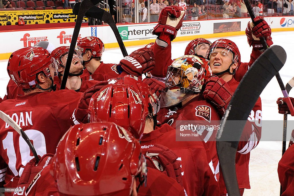 Mike Smith #41 of the Phoenix Coyotes and teammates celebrate Smith's first NHL goal against the Detroit Red Wings at Jobing.com Arena on October 19, 2013 in Glendale, Arizona.
