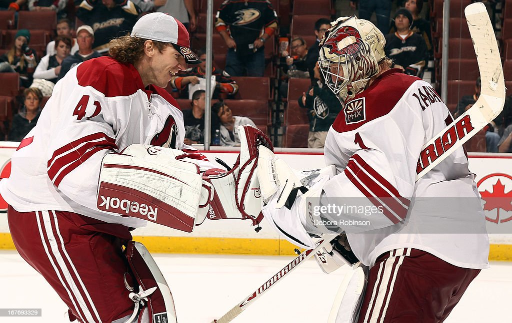 Mike Smith #41 of the Phoenix Coyotes congratulates <a gi-track='captionPersonalityLinkClicked' href=/galleries/search?phrase=Jason+LaBarbera&family=editorial&specificpeople=240674 ng-click='$event.stopPropagation()'>Jason LaBarbera</a> #1 of the Phoenix Coyotes for a 5-3 win over the Anaheim Ducks on April 27, 2013 at Honda Center in Anaheim, California.