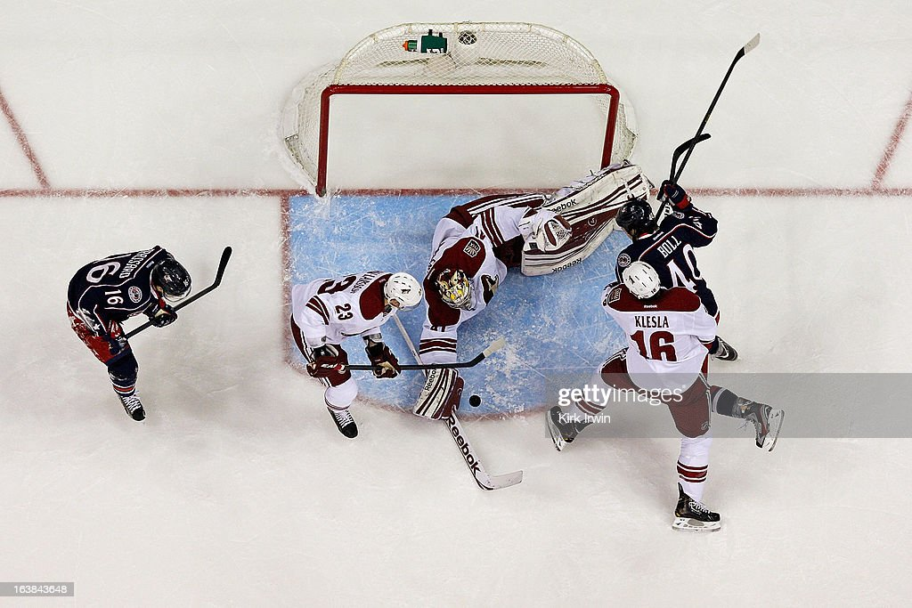 Mike Smith #41 of the Phoenix Coyotes covers up a rebound as <a gi-track='captionPersonalityLinkClicked' href=/galleries/search?phrase=Jared+Boll&family=editorial&specificpeople=2238879 ng-click='$event.stopPropagation()'>Jared Boll</a> #40 of the Columbus Blue Jackets is checked out of position by <a gi-track='captionPersonalityLinkClicked' href=/galleries/search?phrase=Rostislav+Klesla&family=editorial&specificpeople=207079 ng-click='$event.stopPropagation()'>Rostislav Klesla</a> #16 of the Phoenix Coyotes during the first period on March 16, 2013 at Nationwide Arena in Columbus, Ohio. Columbus defeated Phoenix 1-0 in a shootout.
