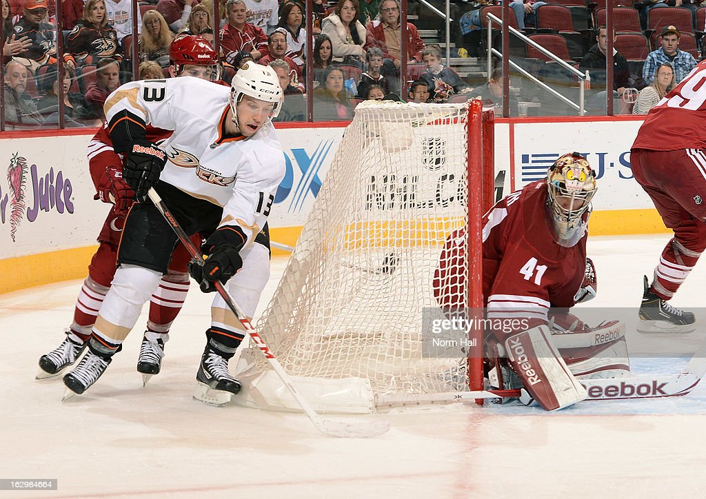 Mike Smith #41 of the Phoenix Coyotes hugs the post as Nick Bonino #13 of the Anaheim Ducks attempts to score on a wrap around move at Jobing.com Arena on March 2, 2013 in Glendale, Arizona.