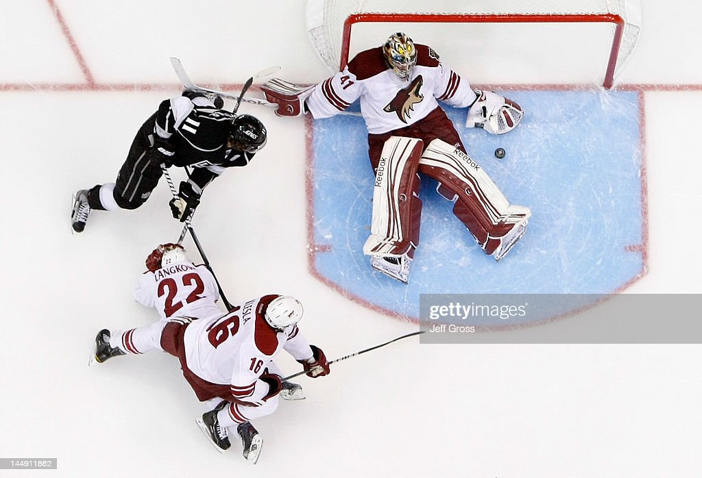 Mike Smith #41 of the Phoenix Coyotes lays on his back as the puck is loose as <a gi-track='captionPersonalityLinkClicked' href=/galleries/search?phrase=Anze+Kopitar&family=editorial&specificpeople=634911 ng-click='$event.stopPropagation()'>Anze Kopitar</a> #11 of the Los Angeles Kings attempts to score in the second period in Game Four of the Western Conference Final during the 2012 NHL Stanley Cup Playoffs at Staples Center on May 20, 2012 in Los Angeles, California.