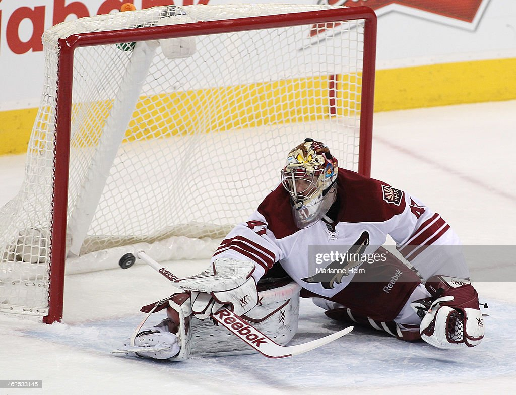 Mike Smith of the Phoenix Coyotes looks back as the puck scores on a shot by Eric O'Dell of the Winnipeg Jets in firstperiod action in an NHL game at...
