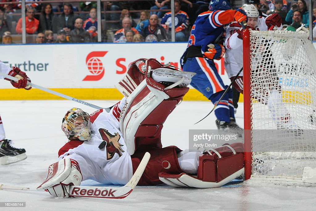 Mike Smith #41 of the Phoenix Coyotes makes a diving save in a game against the Edmonton Oilers on February 23, 2013 at Rexall Place in Edmonton, Alberta, Canada.
