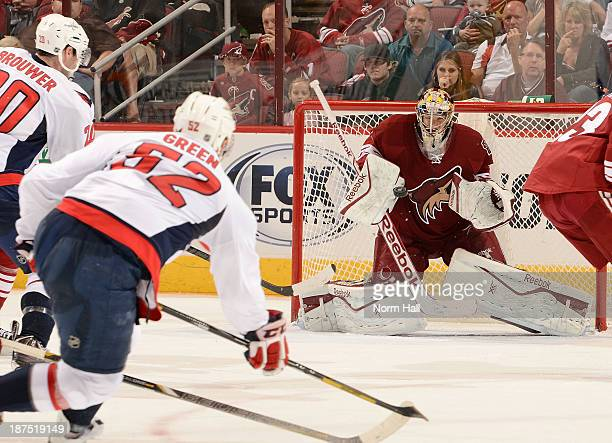 Mike Smith of the Phoenix Coyotes makes a save against Mike Green of the Washington Capitals at Jobingcom Arena on November 9 2013 in Glendale Arizona
