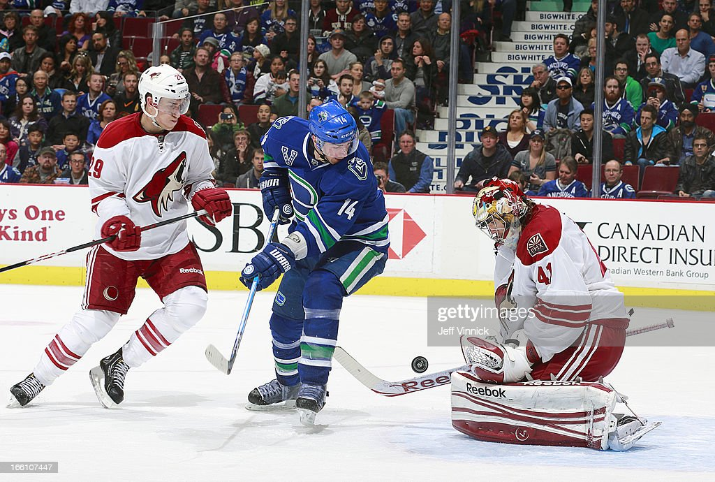 Mike Smith #41 of the Phoenix Coyotes makes a save as Alexandre Burrows #14 of the Vancouver Canucks eyes the rebound in front of Michael Stone #29 of the Coyotes during their NHL game at Rogers Arena April 8, 2013 in Vancouver, British Columbia, Canada.