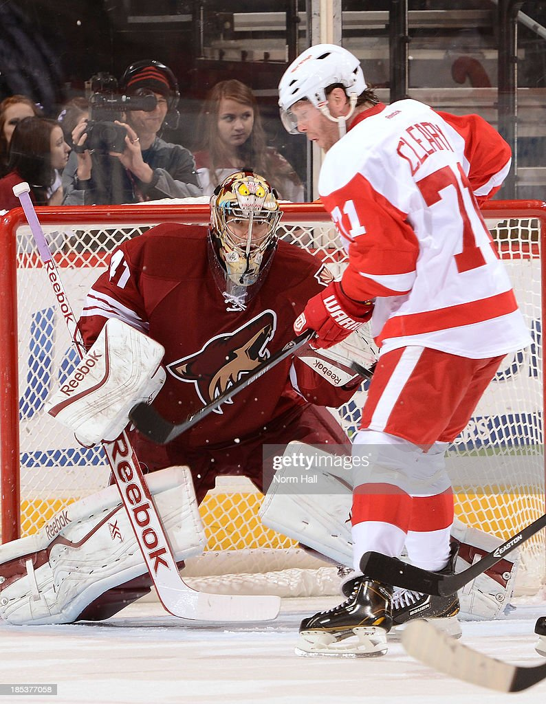 Mike Smith #41 of the Phoenix Coyotes makes a save on a redirected shot by <a gi-track='captionPersonalityLinkClicked' href=/galleries/search?phrase=Daniel+Cleary&family=editorial&specificpeople=220490 ng-click='$event.stopPropagation()'>Daniel Cleary</a> #71 of the Detroit Red Wings at Jobing.com Arena on October 19, 2013 in Glendale, Arizona.