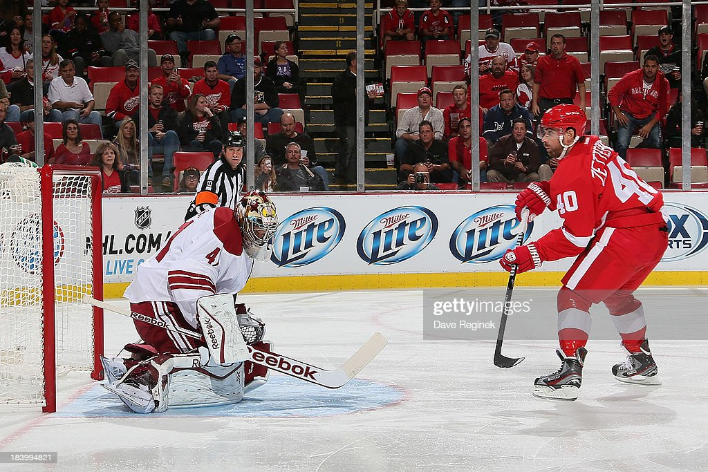 Mike Smith #41 of the Phoenix Coyotes makes a save on <a gi-track='captionPersonalityLinkClicked' href=/galleries/search?phrase=Henrik+Zetterberg&family=editorial&specificpeople=201520 ng-click='$event.stopPropagation()'>Henrik Zetterberg</a> #40 of the Detroit Red Wings during a NHL game at Joe Louis Arena on October 10, 2013 in Detroit, Michigan. The Coyotes won 4-2