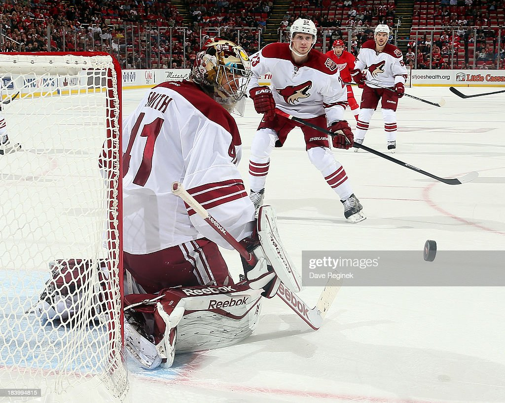 Mike Smith #41 of the Phoenix Coyotes makes a stick save against the Detroit Red Wings during a NHL game at Joe Louis Arena on October 10, 2013 in Detroit, Michigan. The Coyotes won 4-2