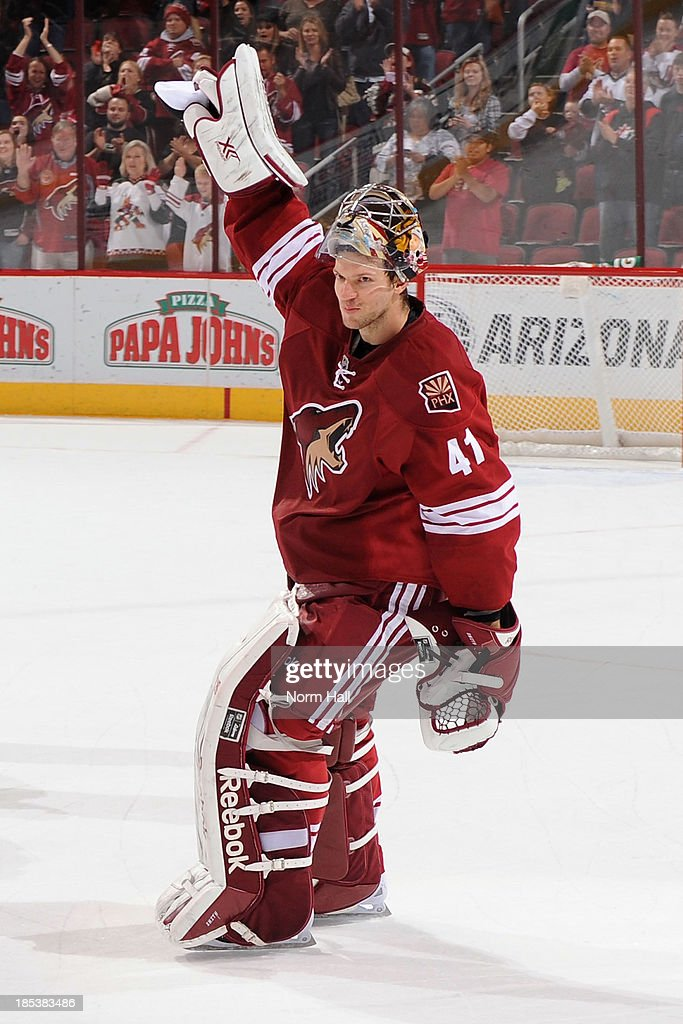 Mike Smith #41 of the Phoenix Coyotes signals to the fans after a win against the Detroit Red Wings at Jobing.com Arena on October 19, 2013 in Glendale, Arizona.