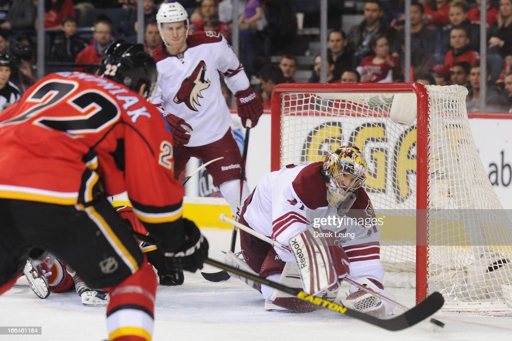 Mike Smith #41 of the Phoenix Coyotes stops a shot in front of Lee Stempniak #22 of the Calgary Flames during an NHL game at Scotiabank Saddledome on April 12, 2013 in Calgary, Alberta, Canada.