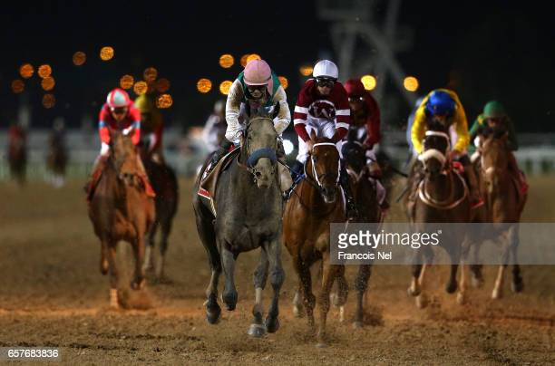 Mike Smith riding Arrogate wins the Dubai World Cup Sponsored By Emirates Airline during the Dubai World Cup at the Meydan Racecourse on March 25...