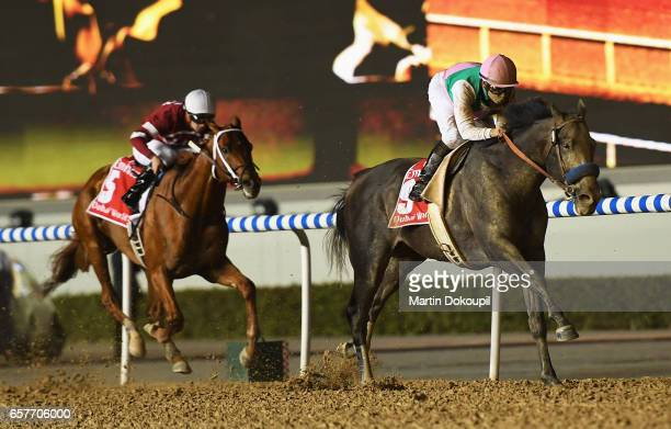 Mike Smith riding Arrogate wins the Dubai World Cup Sponsored By Emirates Airline from Florent Geroux riding Gun Runner during the Dubai World Cup at...