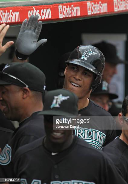 Mike Stanton of the Florida Marlins is greeted by teammates in the dugout after hitting a solo home run in the 4th inning against the Chicago Cubs at...