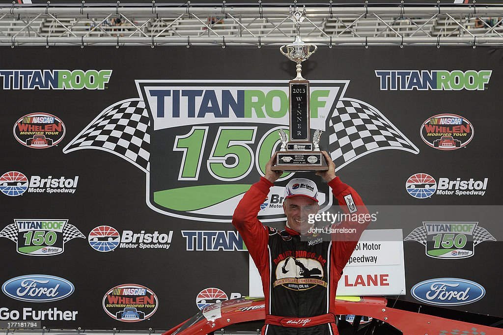Mike Stefanik, driver of the #22 Robert B. Our Co./Canto & Sons Paving Ford, celebrates in Victory Lane after winning the TitanRoof 150 at Bristol Motor Speedway on August 21, 2013 in Bristol, Tennessee.