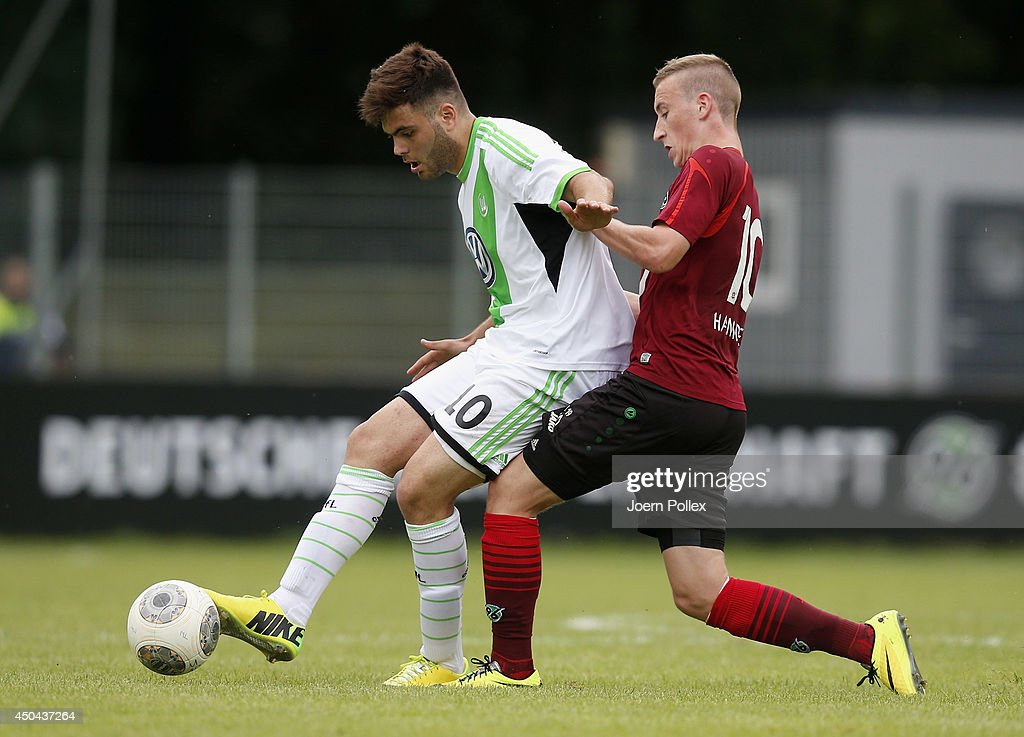 Mike Steven Baehre (R) of Hannover and Kerem Buelbuel of Wolfsburg compete for the ball during the A Juniors Bundesliga Semi Final at Beekestadium on June 11, 2014 in Hanover, Germany.