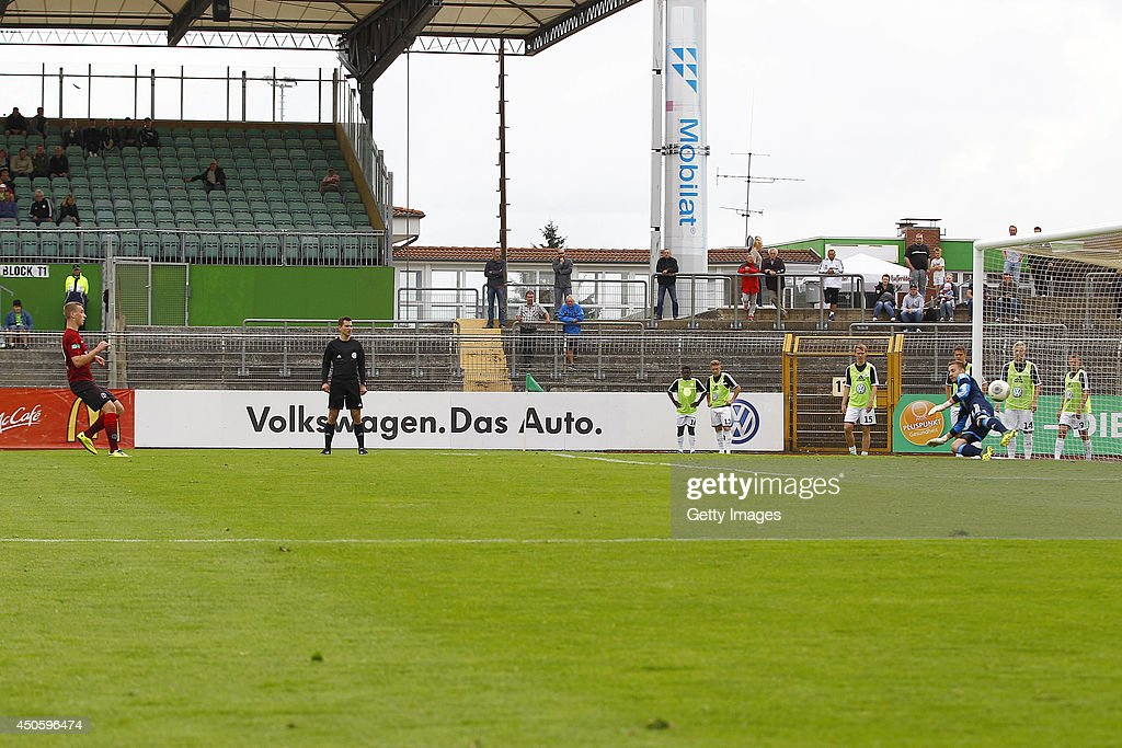 Mike Steven Baehre of Hannover scores the 1:1 against Niklas Klinger of Wolfsburg during the A Juniors Bundesliga Semi Final between U19 VfL Wolfsburg and U19 Hannover 96 at Stadion am Elsterweg on June 14, 2014 in Wolfsburg, Germany.