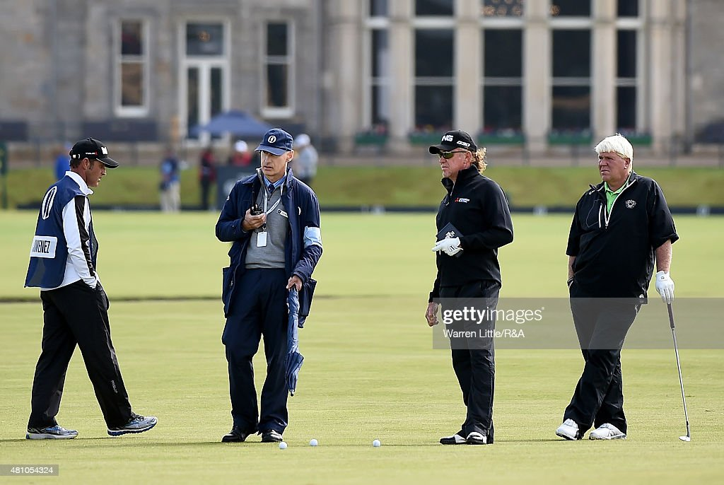 Mike Stewart (2nd L) of the European Tour liases with televsion regarding a ruling for <a gi-track='captionPersonalityLinkClicked' href=/galleries/search?phrase=Miguel+Angel+Jimenez&family=editorial&specificpeople=171700 ng-click='$event.stopPropagation()'>Miguel Angel Jimenez</a> (2nd R) of Spain as caddie Clifford Botha (L) and golfer <a gi-track='captionPersonalityLinkClicked' href=/galleries/search?phrase=John+Daly+-+Golfer&family=editorial&specificpeople=4350901 ng-click='$event.stopPropagation()'>John Daly</a> (R) look on during the second round of the 144th Open Championship at The Old Course on July 17, 2015 in St Andrews, Scotland.