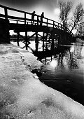 Mike Stoffa and his son Jon both of Rockport look out from Old North Bridge in Concord Mass on Feb 24 1983