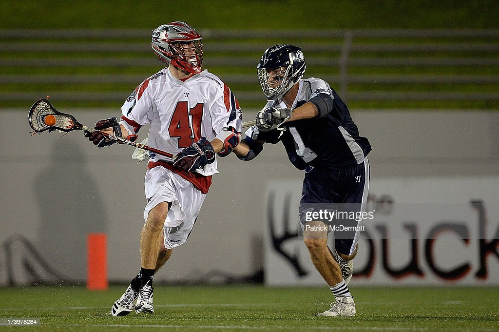 Mike Stone #41 of Boston Cannons battles against Dan Burns #4 of Chesapeake Bayhawks during a game at Navy-Marine Corps Memorial Stadium on July 18, 2013 in Annapolis, Maryland.
