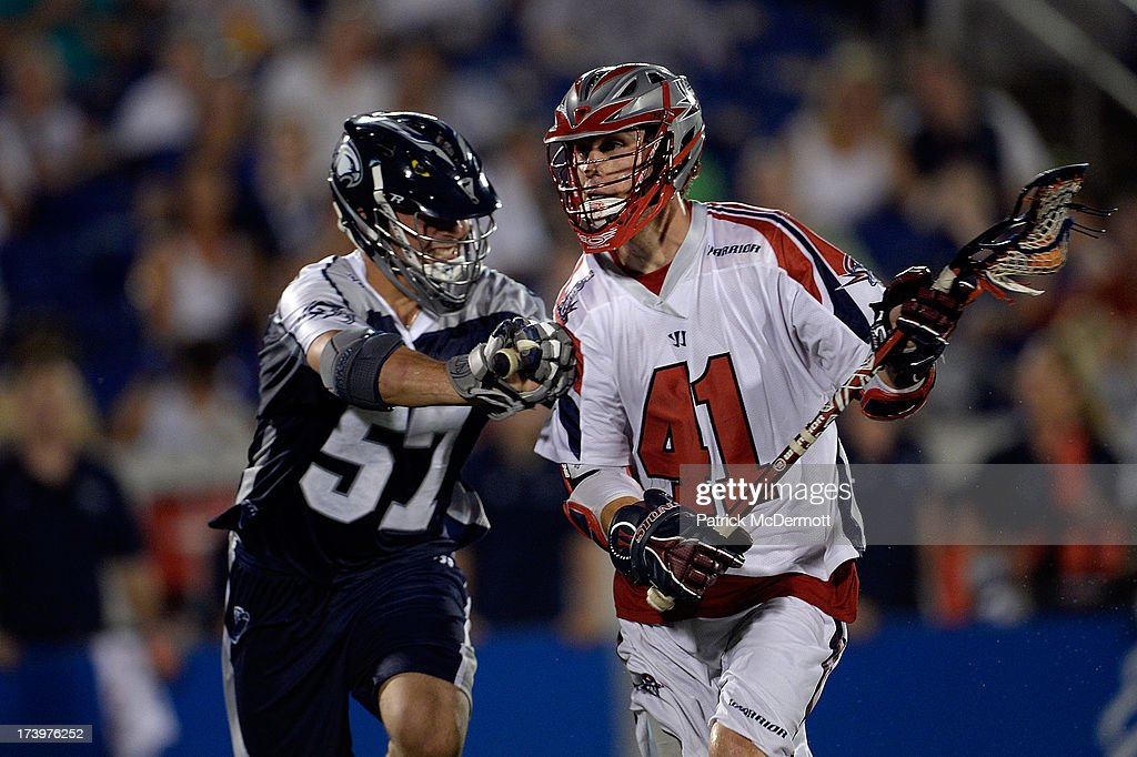 Mike Stone #41 of Boston Cannons battles against Domenic Sebastiani #57 of Chesapeake Bayhawks during a game at Navy-Marine Corps Memorial Stadium on July 18, 2013 in Annapolis, Maryland.