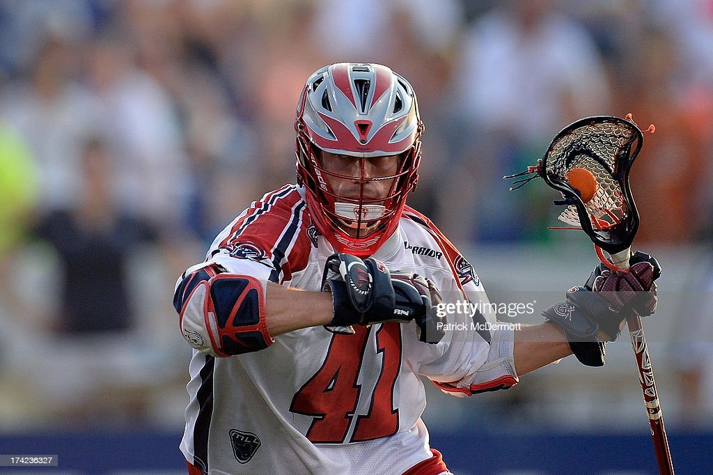 Mike Stone #41 of Boston Cannons brings the ball up field against the Chesapeake Bayhawks during a game at Navy-Marine Corps Memorial Stadium on July 18, 2013 in Annapolis, Maryland.