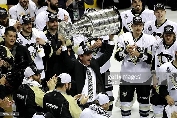 Mike Sullivan of the Pittsburgh Penguins celebrates with the Stanley Cup after their 31 victory to win the Stanley Cup against the San Jose Sharks in...