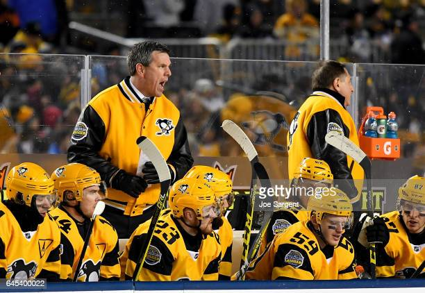Mike Sullivan of the Pittsburgh Penguins coaches against the Philadelphia Flyers during the 2017 Coors Light NHL Stadium Series at Heinz Field on...