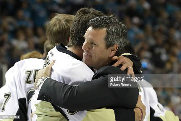 Mike Sullivan of the Pittsburgh Penguins hugs retired Pittsburgh Penguins Pascal Dupuis after winning the Stanley Cup against the San Jose Sharks 31...