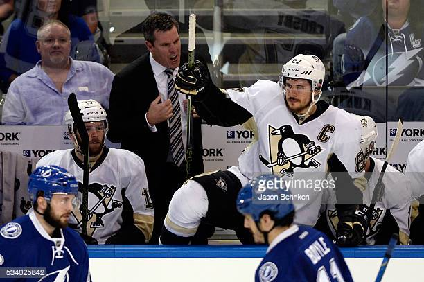 Mike Sullivan of the Pittsburgh Penguins shouts as Sidney Crosby takes the ice during the first period against the Tampa Bay Lightning in Game Six of...