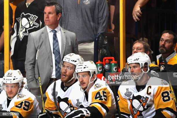 Mike Sullivan of the Pittsburgh Penguins watches his team play during the second period of Game Four of the 2017 NHL Stanley Cup Final at Bridgestone...