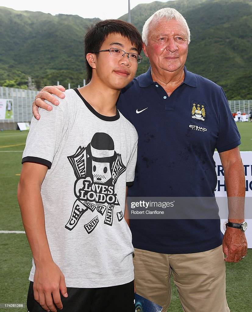 Mike Summerbee poses with a fan during the Premier Skills and Creating Chances open day on July 23, 2013 in Hong Kong, Hong Kong.