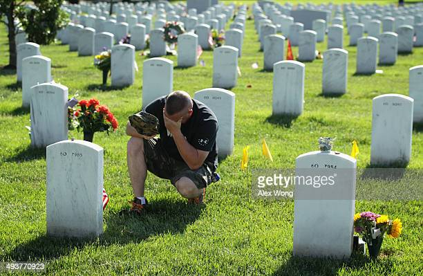 Mike Sunderhaus of Belair Maryland becomes emotional as he visits the grave site of his friend US Marine Corps Lance Corporal Jeremiah E Savage who...