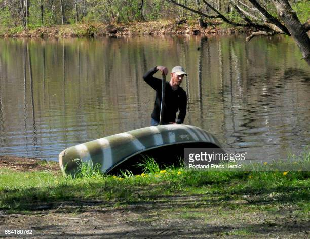 Mike Switzer pulls a canoe from Outlet Stream near a water park in Vassalboro on Tuesday May 16 2017 Switzer said the water he canoed was calm but...
