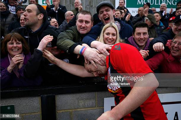 Mike Symons of Hereford celebrates with fans after his teams victory in the FA Vase Semi Final Second Leg Match between Salisbury and Hereford at The...