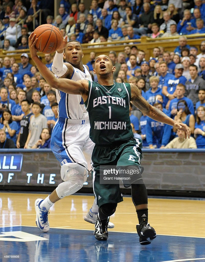Mike Talley #1 of the Eastern Michigan Eagles drives against <a gi-track='captionPersonalityLinkClicked' href=/galleries/search?phrase=Rasheed+Sulaimon&family=editorial&specificpeople=7887134 ng-click='$event.stopPropagation()'>Rasheed Sulaimon</a> #14 of the Duke Blue Devils during their game at Cameron Indoor Stadium on December 28, 2013 in Durham, North Carolina. Duke won 82-59.