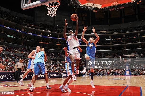 Mike Taylor of the Los Angeles Clippers goes up for a shot against Chris Andersen of the Denver Nuggets at Staples Center on October 24 2008 in Los...