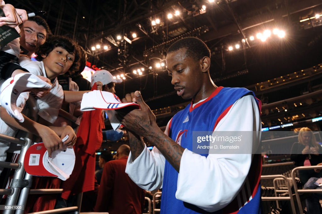 MIke Taylor #4 of the Los Angeles Clippers signs autographs for fans before the game against the Denver Nuggets at Staples Center on November 26, 2008 in Los Angeles, California.