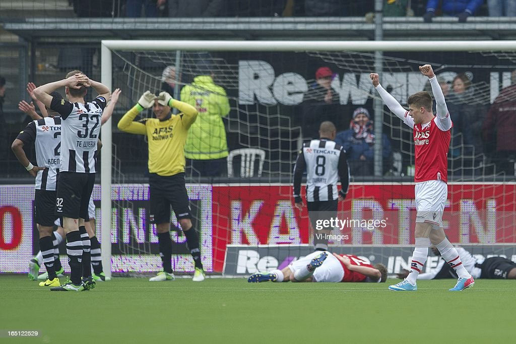 Mike te Wierik of Heracles Almelo, Johann Berg Gudmundsson of AZ during the Dutch Eredivisie match between Heracles Almelo and AZ Alkmaar at the Polman Stadium on march 31, 2013 in Almelo, The Netherlands